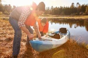Father & son prepping kayak
