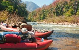 Inflatable kayaks on waters edge