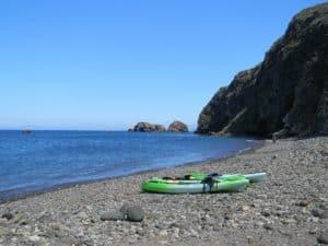 Sit-on-top kayaks on the beach