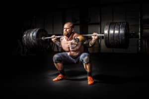 Man Squatting Big Weights